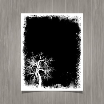Black grunge poster with a tree