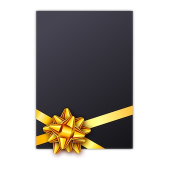 Black holiday gift card with golden ribbon and bow