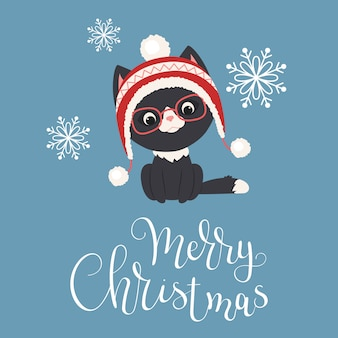 Black kitten in winter hat and glasses with snowflakes