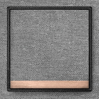 Черная кожаная рамка на сером фоне текстуры ткани