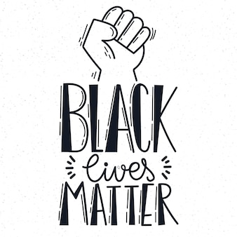 Black lives matter lettering with fist