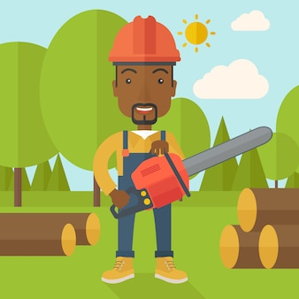 Black lumberjack cuts a tree by chainsaw.
