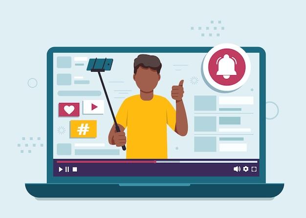 Черный блоггер-мужчина ведет видеоблог с иллюстрацией селфи-камеры