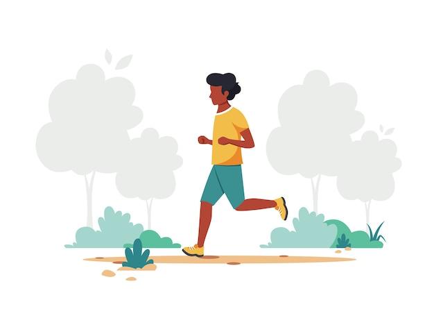 公園でジョギングしている黒人男性