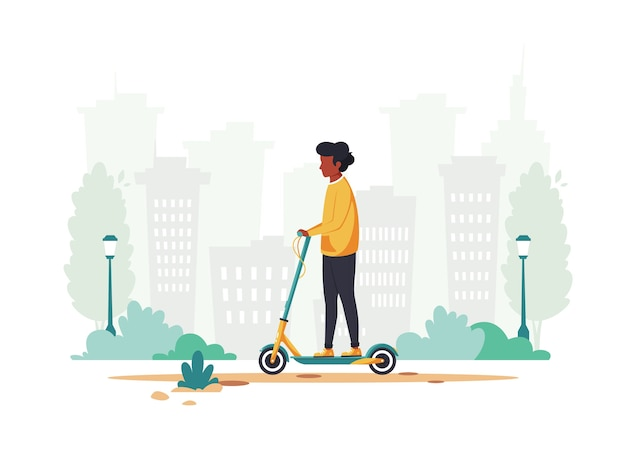 Black man riding electric scooter in the city