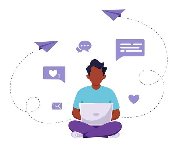 Black man sitting with laptop. freelance, remote work