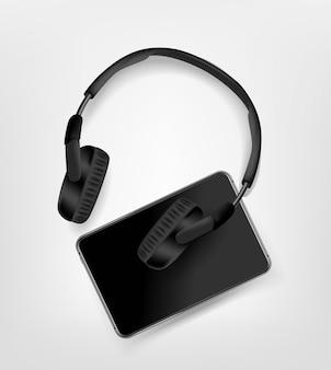 Black modern wireless headphones and black tablet