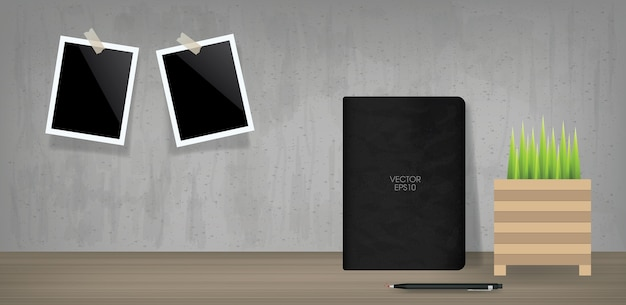 Black notebook and blank photo frame in vintage room space background