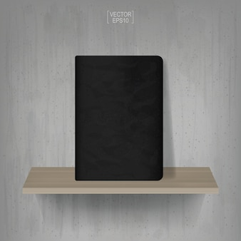 Black notebook on wooden shelf with vintage concrete wall background. vector illustration.