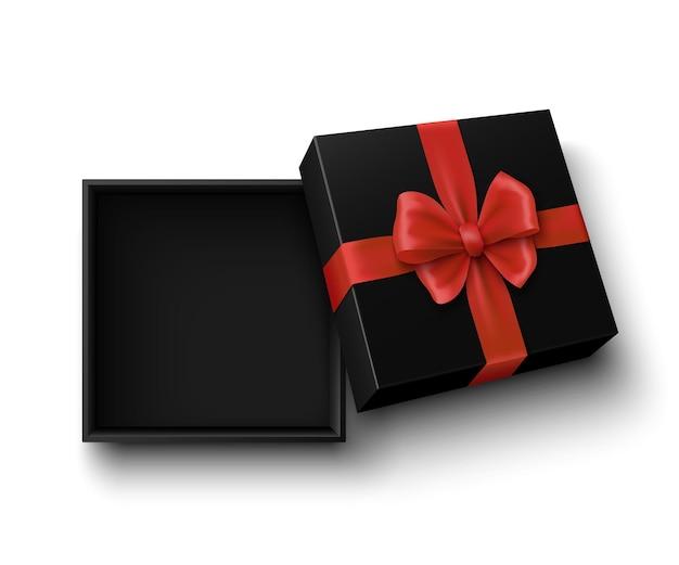 Черная открытая подарочная коробка с красным бантом на белом