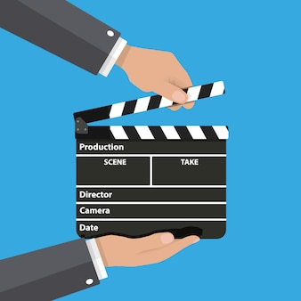 Black opened clapperboard in hands.