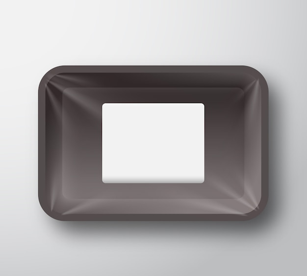 Black plastic empty food tray container with transparent cellophane cover and clear white rectangle sticker