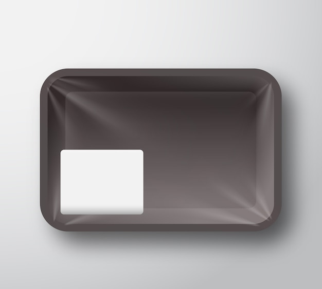 Black plastic food tray container with transparent cellophane cover and clear white sticker