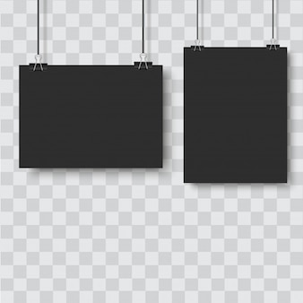 Black poster hanging with binder on transparent background