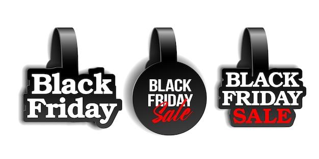 Черные реалистичные рекламные воблеры для супер распродажи black friday. шаблон этикетки для рекламы розничной продажи, скидки или специального предложения. образец для вашего баннера или плаката.