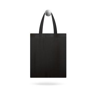Черная реалистичная сумка-тоут висит на дверной ручке