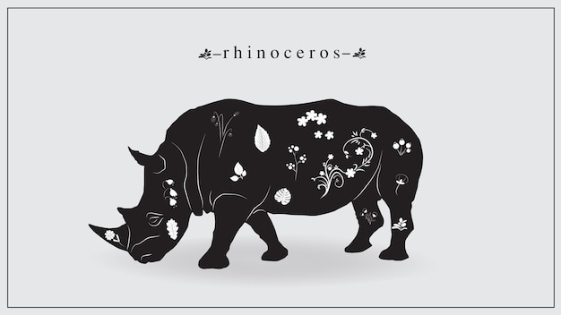 Black rhinoceros with white flowers and plants.