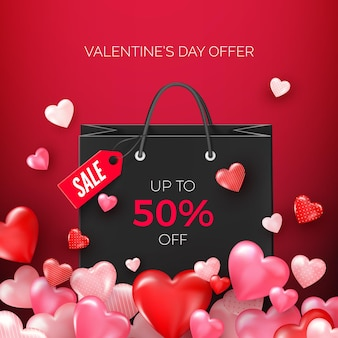 Black shopping bags with discount offer with flying hearts. sale valentine's day promotion
