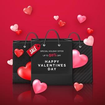 飛んでいるハートの割引オファー付きの黒いショッピングバッグ。バレンタインデーのプロモーション
