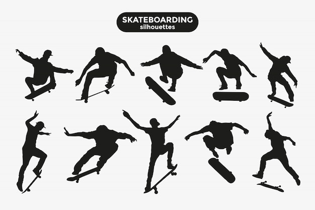 Black silhouettes of skateboarders on a gray