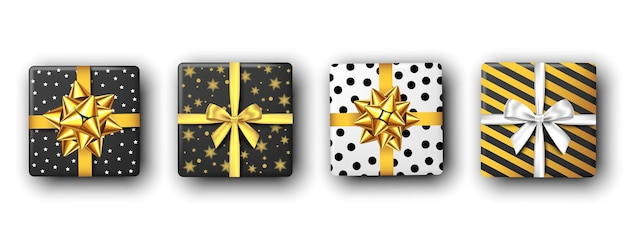 Black and white gift box with silver and golden ribbon and bow, top view