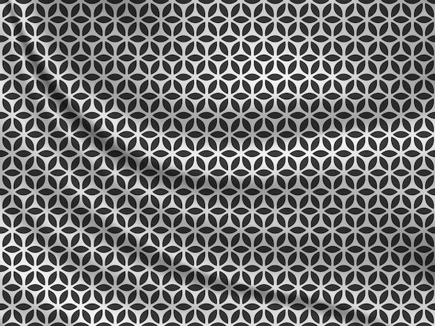 Black and white oriental pattern on wavy silk fabric.