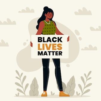 Donna di colore che tiene il cartello della materia delle vite nere