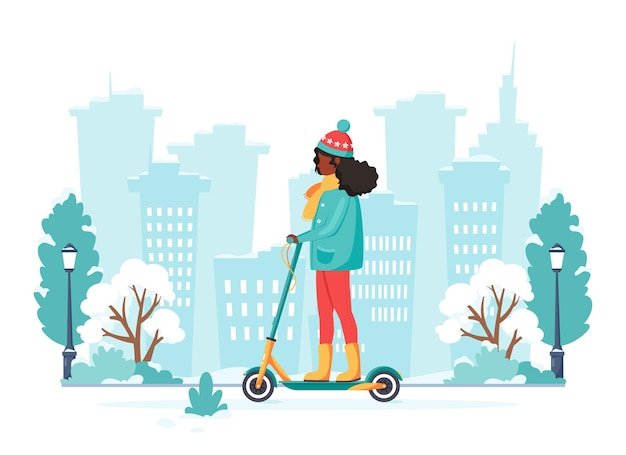 Black woman riding electric kick scooter in winter