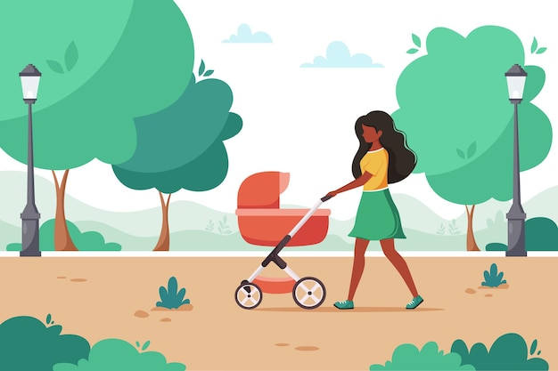 Black woman walking with baby carriage in city park