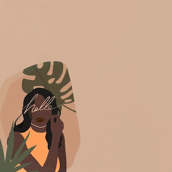 Donna di colore con una foglia di monstera