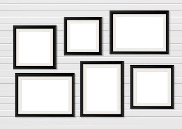 벽에 검은 나무 사진 프레임 모형. 인테리어 장식