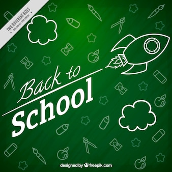Blackboard background with rocket and materials