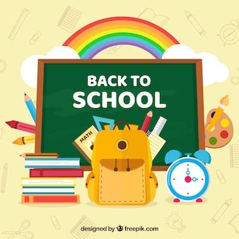Blackboard background with school supplies