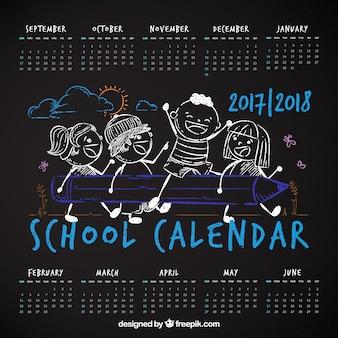 Blackboard school calendar with sketches
