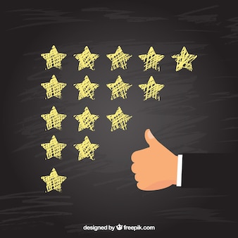 Blackboard star rating concept with hand making ok gesture