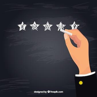 Concetto di valutazione a stelle lavagna con mano