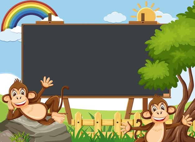 動物園で幸せな猿と黒板テンプレートデザイン