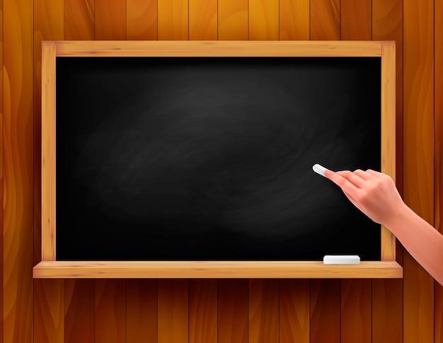 木製の背景に手で黒板