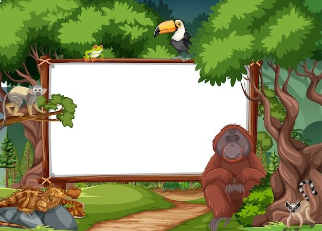 Пустой баннер в тропическом лесу с дикими животными Бесплатные векторы