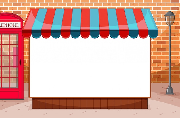 Blank banner with awning in city on brick wall scene