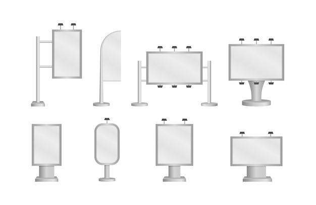白い背景の上の白いライトと空白の大きな看板。広告やマーケティングプロモーションのための都市のバナー、ポスター、看板のリアルなモックアップとテンプレートのセット。ベクター。