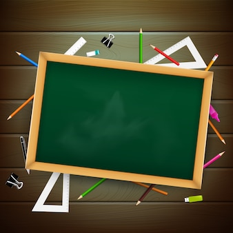 Blank black board on wooden background