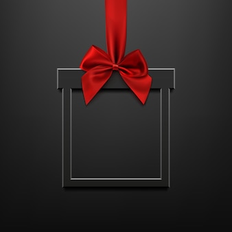 Blank, black, square banner in form of christmas gift with red ribbon and bow, black illuminated background. brochure or banner template.