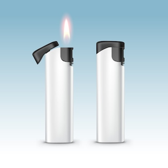 Blank black white plastic lighters with flame close up