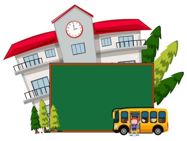 Blank blackboard infront of school with bus