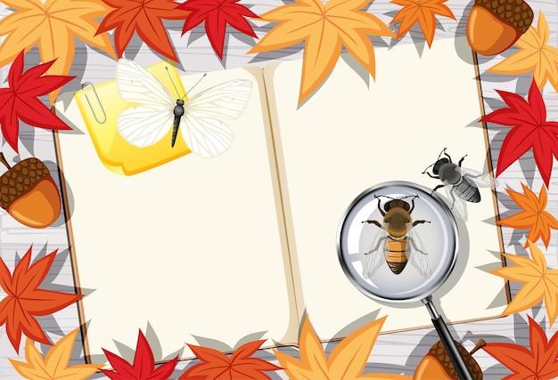 Pagina del libro in bianco sul lavoro d'ufficio con foglie e insetti
