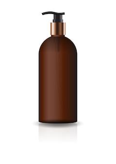 空の茶色の化粧品ラウンドボトル、ポンプヘッド付き。