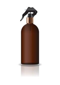 空の茶色の化粧品ラウンドボトルにスプレーヘッド。