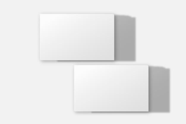Modello di biglietto da visita vuoto in tono bianco con vista anteriore e posteriore
