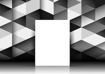 Blank canvas leaning against a wall with a geometric pattern